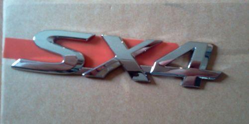 Suzuki SX4 embléma, dísz felirat, logó 77831-79J00-0PG  Gyári. Ft/db 3900Ft